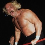 picture of shirtless Jesse Ventura, hair wild, mouth open