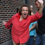 photo of Richard Simmons wearing a red shirt with (seemingly) no pants.